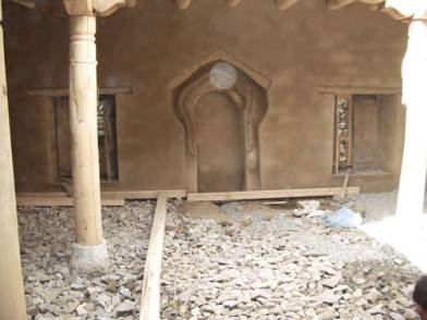 Walls reconstructed and plastered, historic prayer niche (Mirhab) preserved