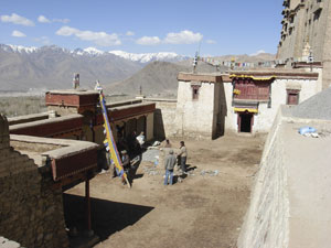 Gonpa Soma courtyard before paving: the sand surface turns muddy after rain or snow