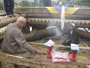 The former king of Jentsa performs blessing puja for new roof