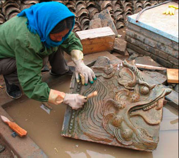 The historic tiles are carefully cleaned before reassembly
