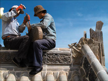 THF team re-tiling Serkhang's roof with historic and replacement tiles especially made for the project