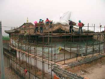 Dismantling of the gabled roof over Sangye Lhakhang began in May