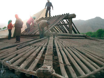 Following ancient Japanese and Chinese traditions, restoration of the massive gabled roofs requires careful extracting each timber element.