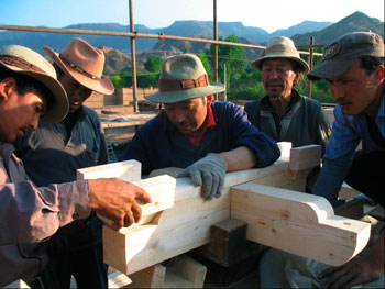 The Tibetan carpenters have prepared new dougong brackets to replace the cracked and broken ones