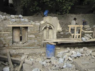Partial reconstruction of damaged Masjid walls, Mirhab niche in centre was preserved