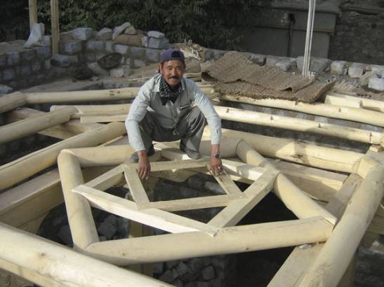 Carpenter fixing the wooden lantern. The lantern connects all floors, and symbolises the different cultures living together in Ladakh.