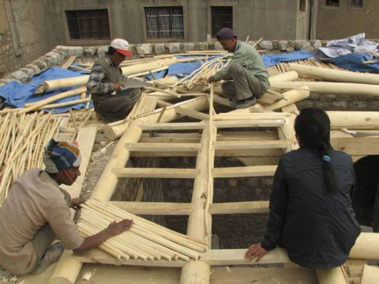Making of the roof with twigs called Taloo.