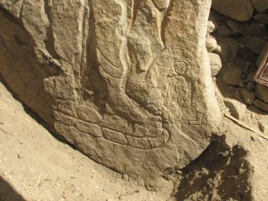 Detail of the inscription and devotional female figure