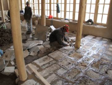 Paving of floor of first floor with slate stone.