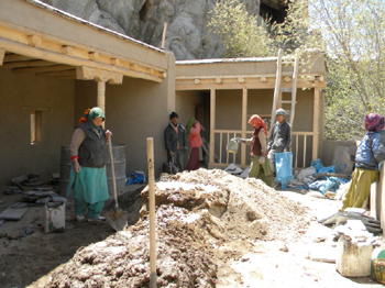 Preparing the mud mortar for stone paving and finishings.