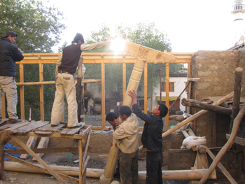 Carpenters putting in place the pillar and bracket in the first floor of Kawoo house.