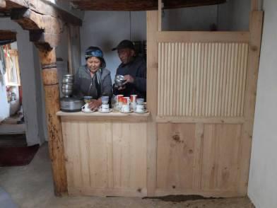 Rigzin Dolma and Dawa  making tea in their new kitchen in Gotal Murup house.