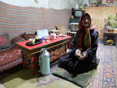 Tsangspa house' sowner Mrs Tsering Putit in her living room.