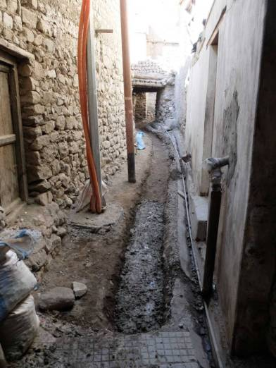 THF/LOTI, after discussing with the residents, created a section of public gutter and water supply line.