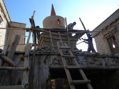 The team first removed the cement and recover as much as the original shape of the stupa.