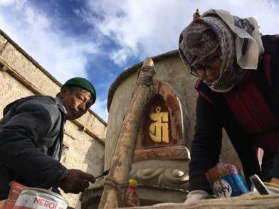 Tsering Bloo and Yanchen working on repairing the decorative elements of the stupa.