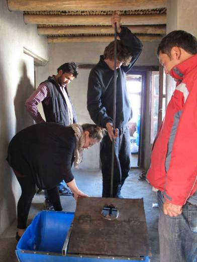 Ludwig, Julia, Vivek and Stanzin testing the device to separate solid and liquid waste of the water flush toilets.
