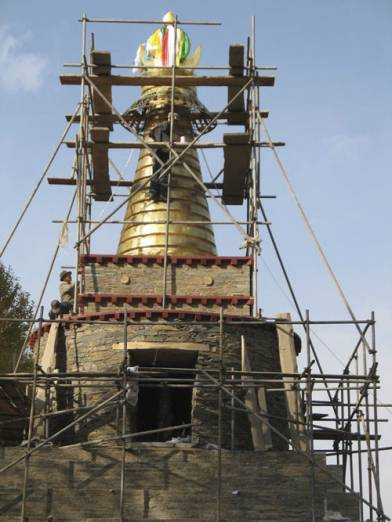 THF builds stupa in traditional stone work