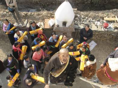 the local community fills the stupa with copies of the Kanjur