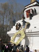 The stupa's gokyim is lifted up for sealing the interior after filling it with incense, Kanjur and other newly-made items