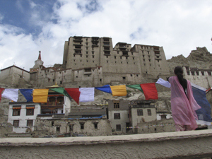 Local team member Sonam Yangzes hosting prayerflags in Leh old town.