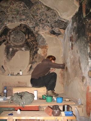 Christine Jürgens cleaning murals in Achung Namdzong