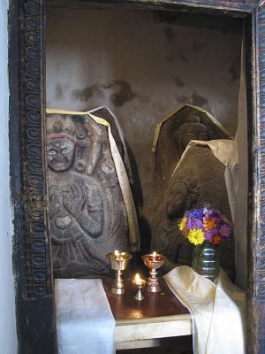The restored shrine room with five ancient stone-carved Buddha images.